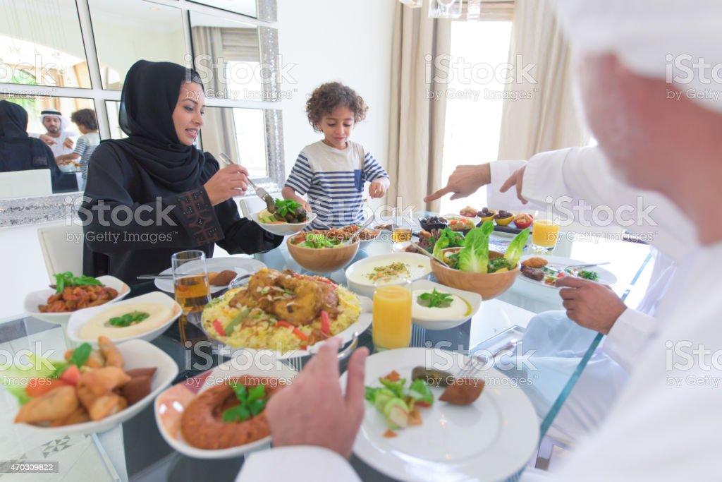 Three generation Arabic family enjoying lunch stock photo