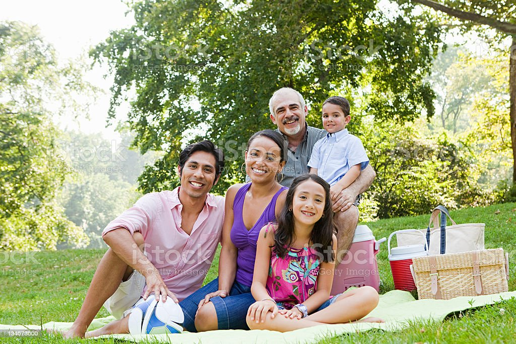 Three generation family at picnic in park, portrait stock photo