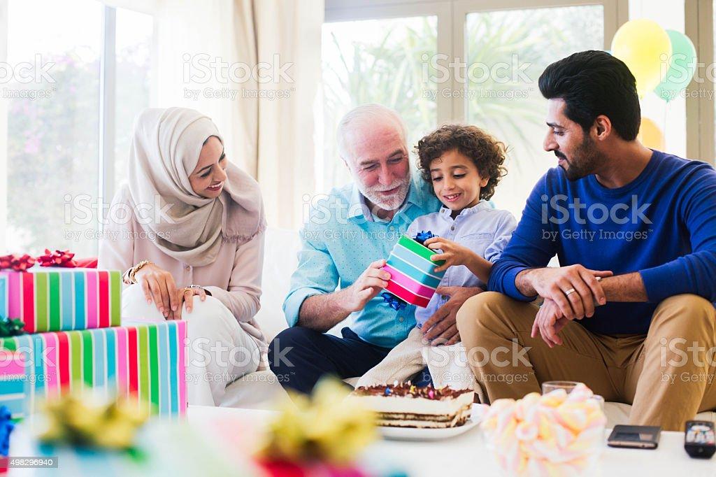 Three generation family celebrating a birthday in Dubai. stock photo