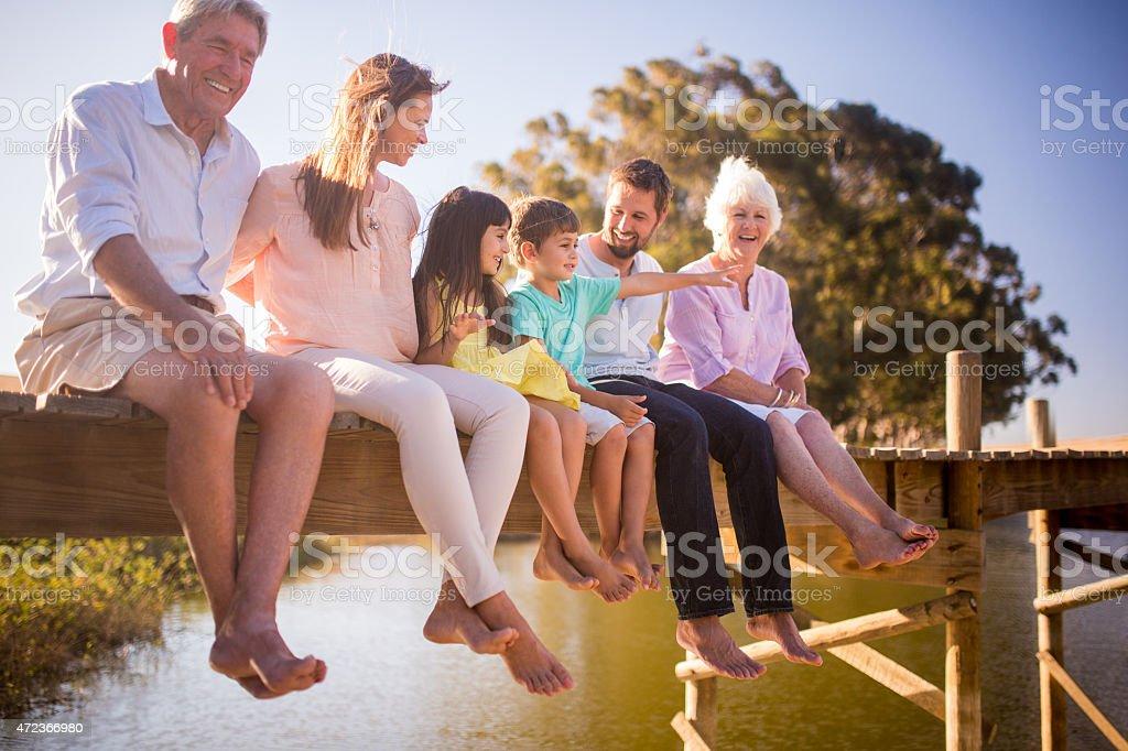 Three generation family enjoying a summer vacation together stock photo