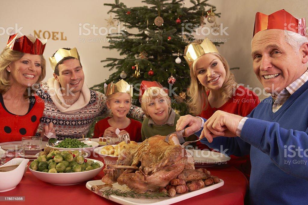 Three Generation Family Enjoying Christmas Meal At Home royalty-free stock photo