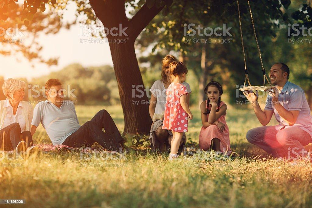 Three Generation Family Having Fun At Picnic. stock photo