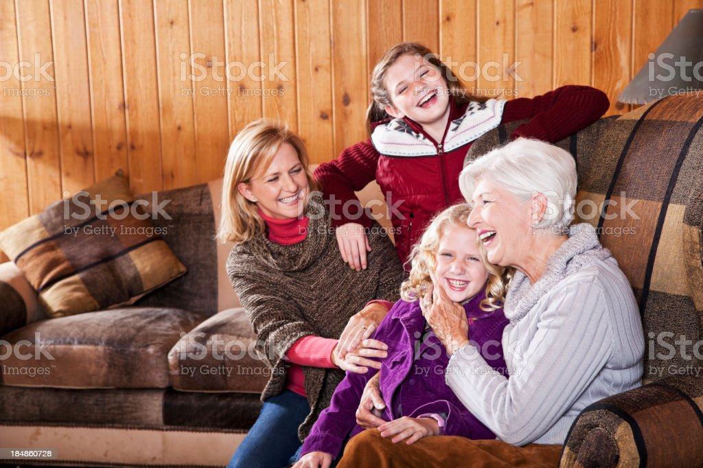 Three generation family in cabin living room royalty-free stock photo