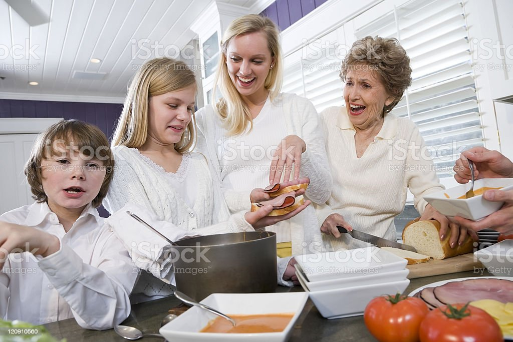 Three generation family in kitchen eating lunch royalty-free stock photo