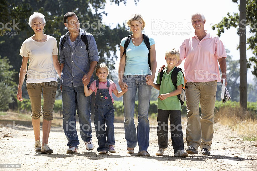 Three generation family on country walk royalty-free stock photo