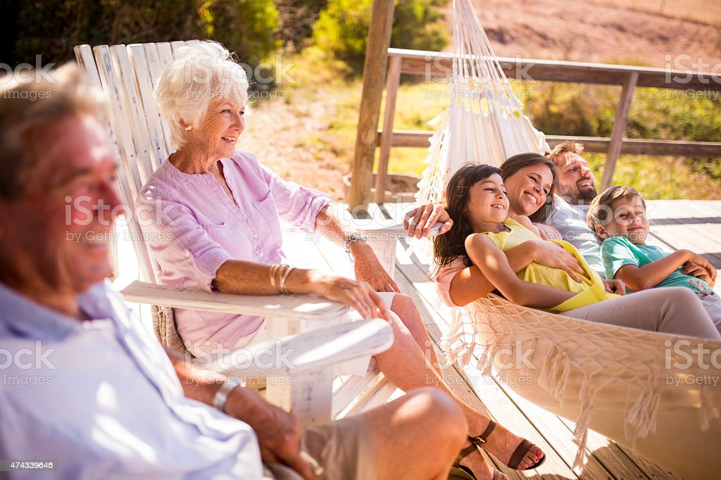 Three generation family outside together on a summer day stock photo