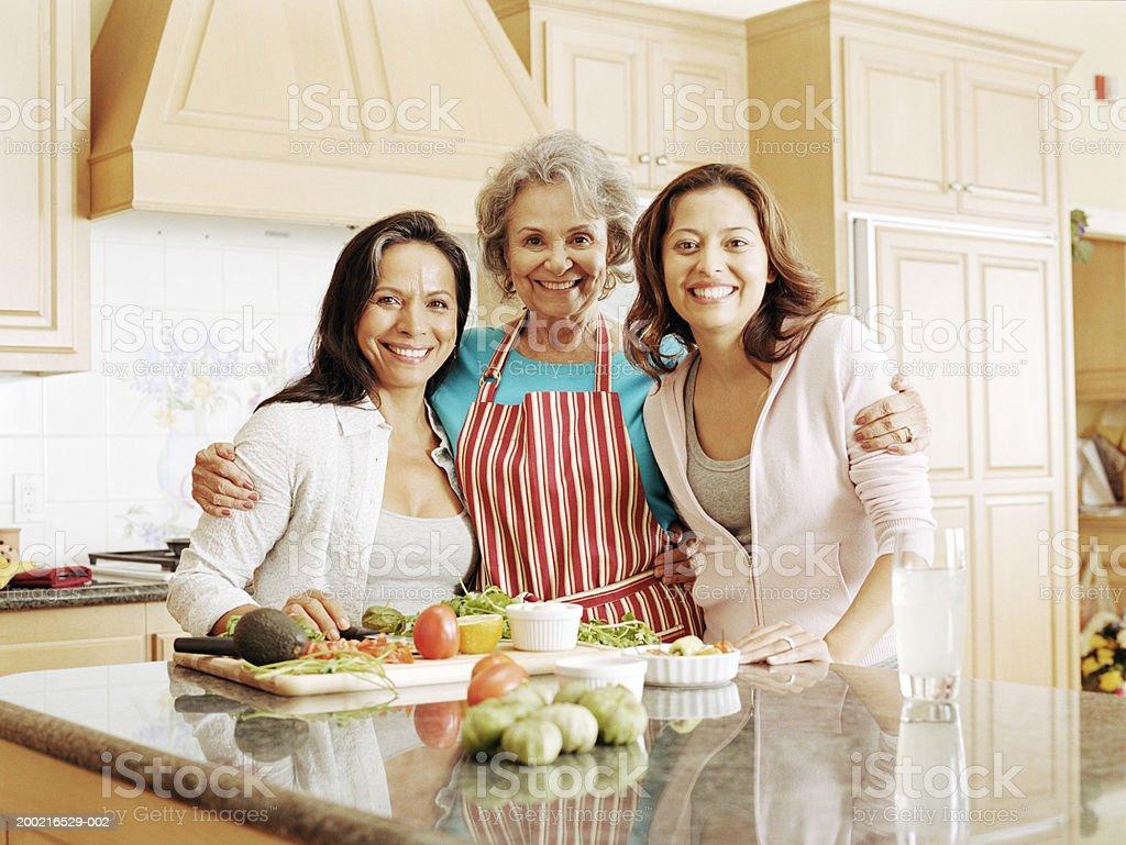 Three generation family preparing food in kitchen, portrait royalty-free stock photo