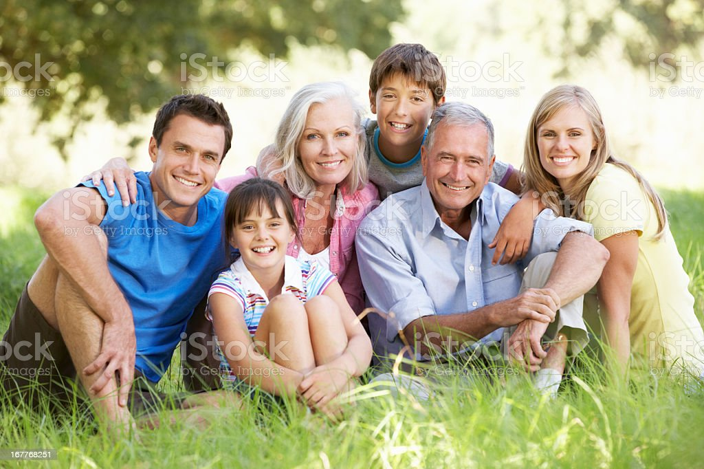 Three Generation Family Relaxing In Summer Field royalty-free stock photo