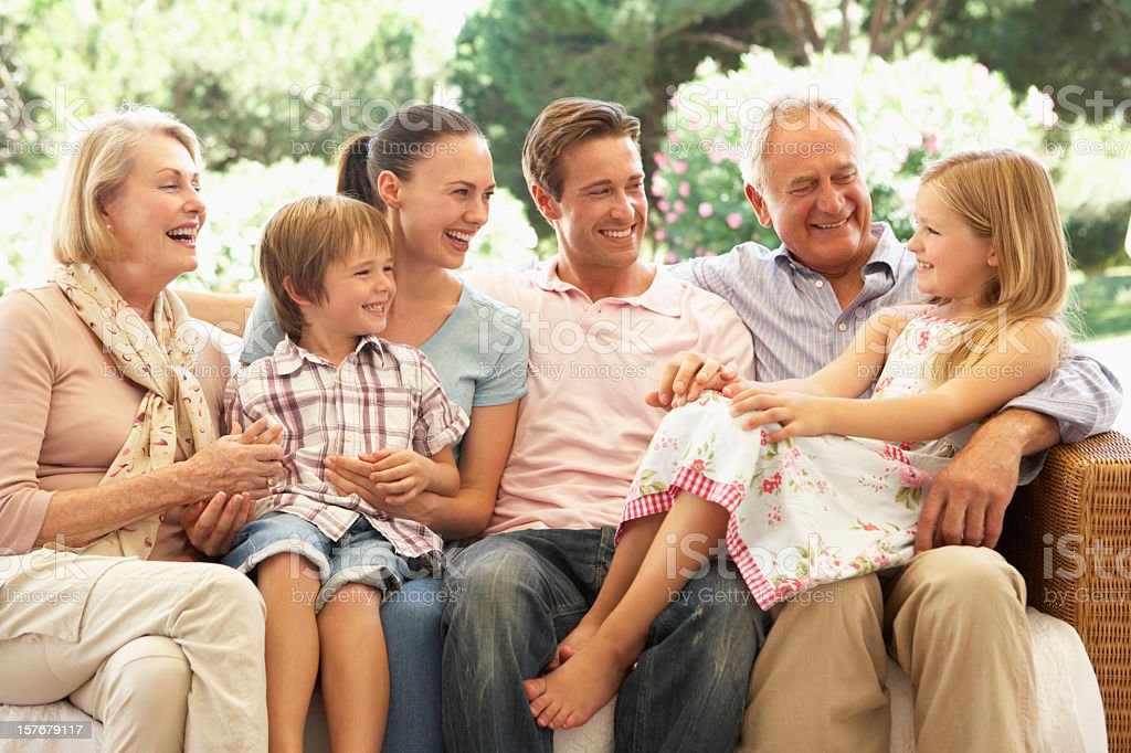 Three Generation Family Sitting On Sofa royalty-free stock photo