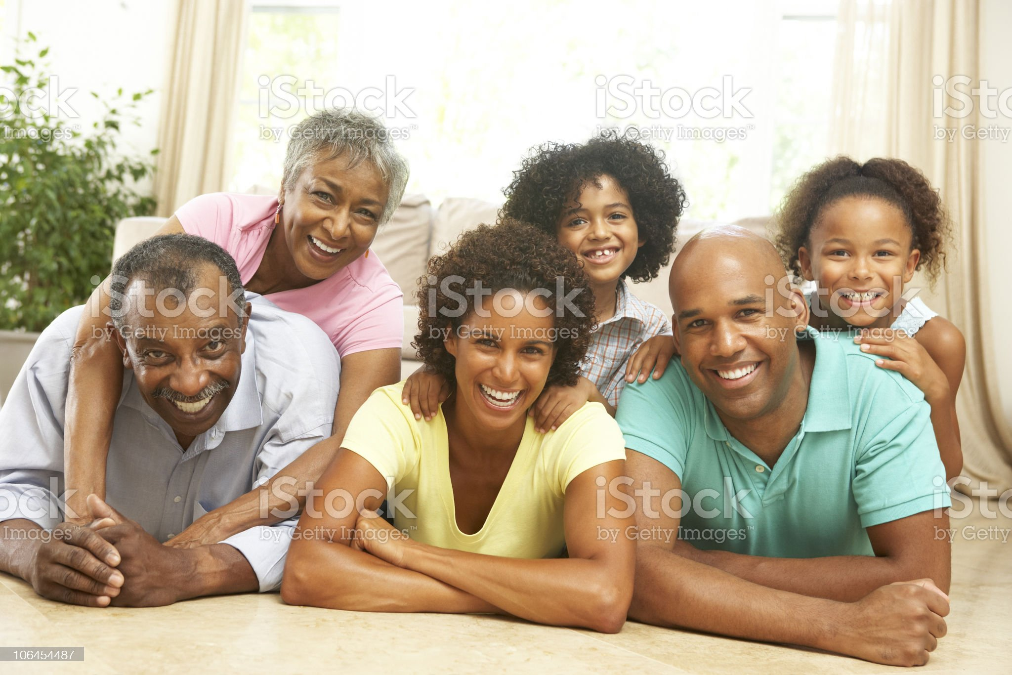 Three generation family smiling at home royalty-free stock photo