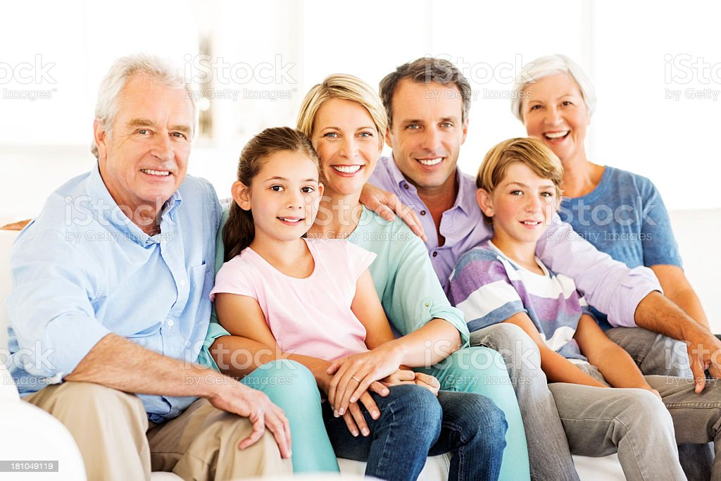 Three Generation Family Smiling At Home stock photo