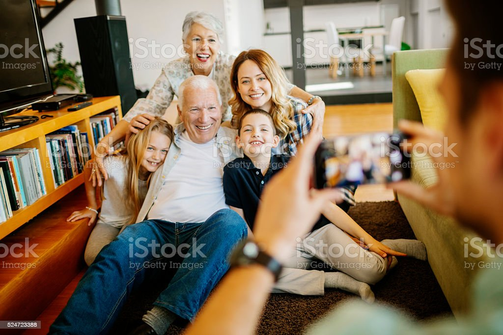 Three generation family taking photo of themselves stock photo