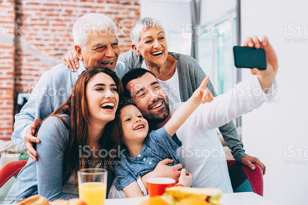 Three generation family taking selfie stock photo