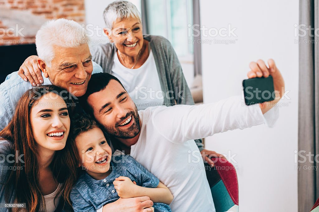 Three generation family taking selfie stock photo