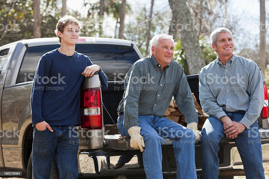Three generation family with pickup truck royalty-free stock photo