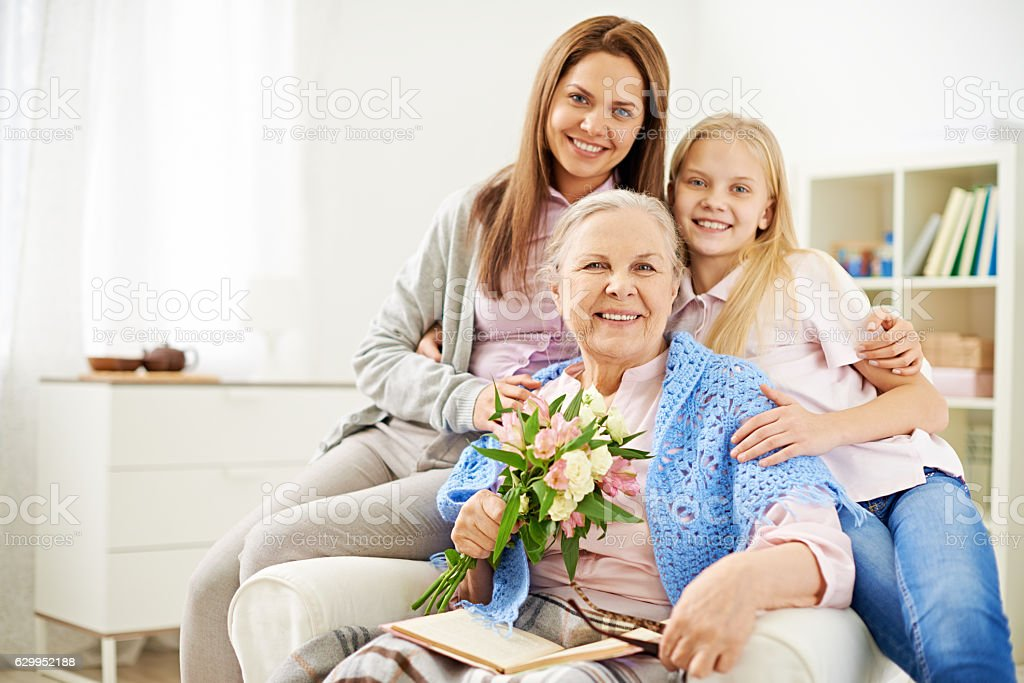 Three generation females looking at camera stock photo