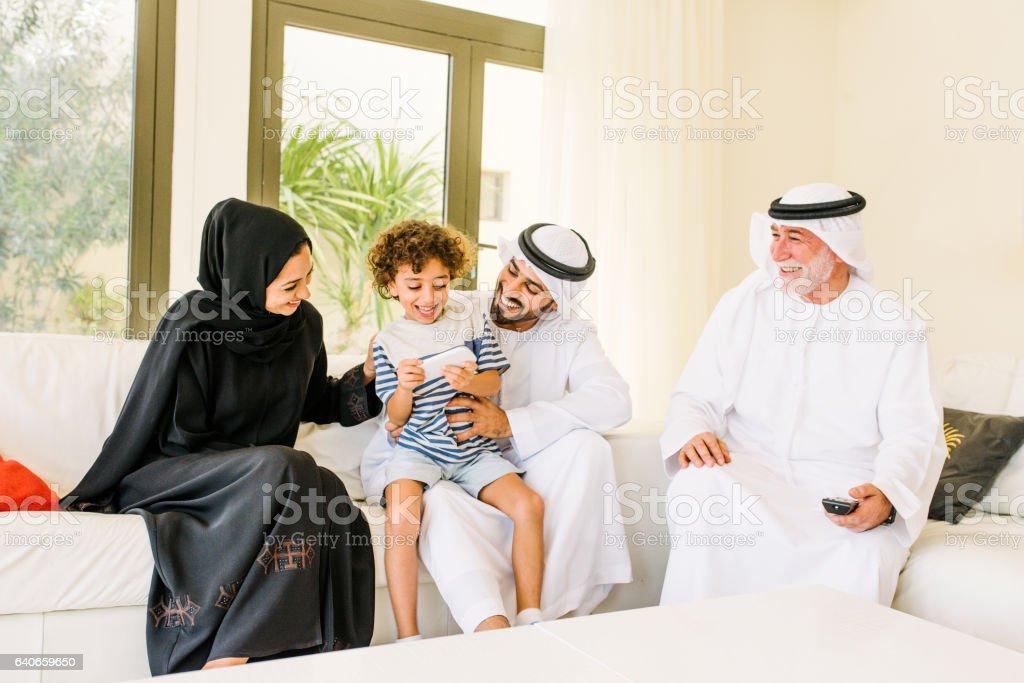 Three generation happy Arabic family at home stock photo