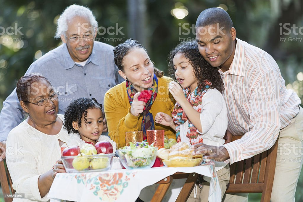 Three generation Hispanic family picnic stock photo