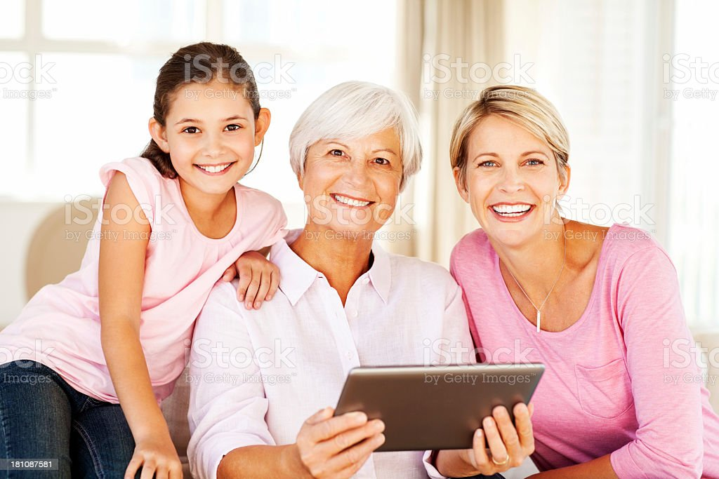 Three Generation Of Family With Digital Tablet At Home royalty-free stock photo