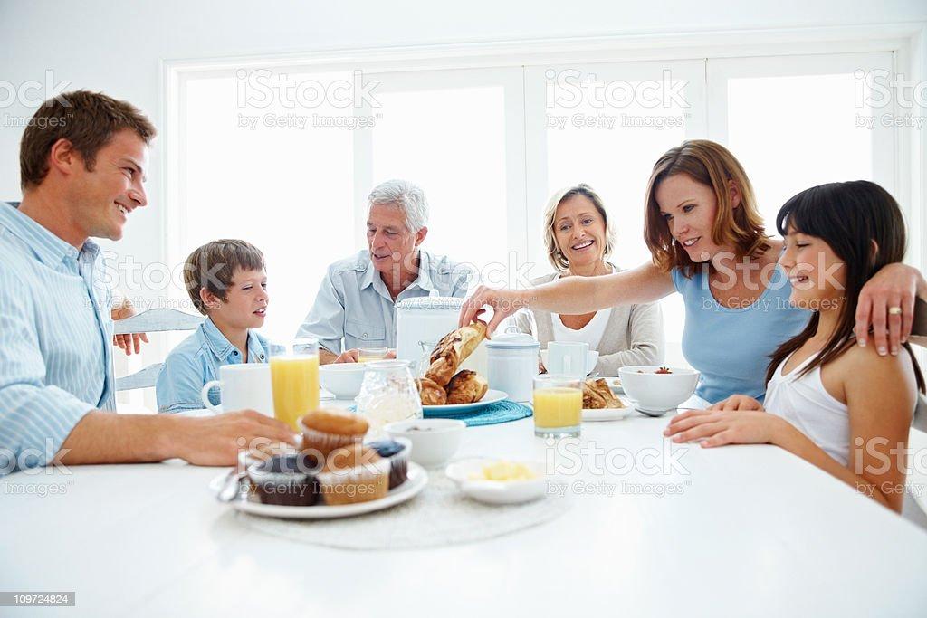 Three generational family enjoying a healthy breakfast royalty-free stock photo