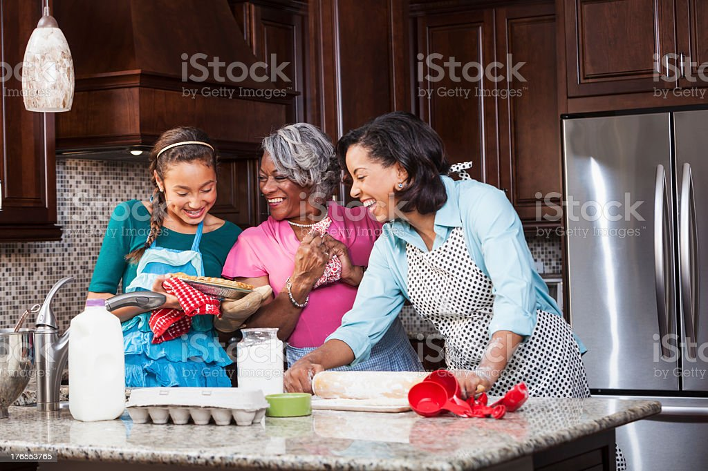 Three generations baking stock photo