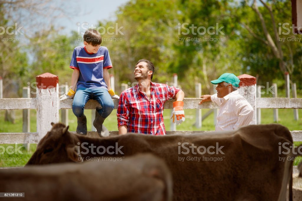 Three Generations Family Of Farmers Laughing In Farm stock photo