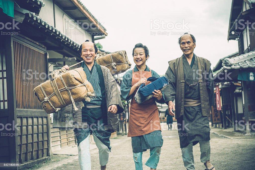 Three Generations Happy Japanese Peasants Walking, Edo Period, Kyoto, Japan stock photo