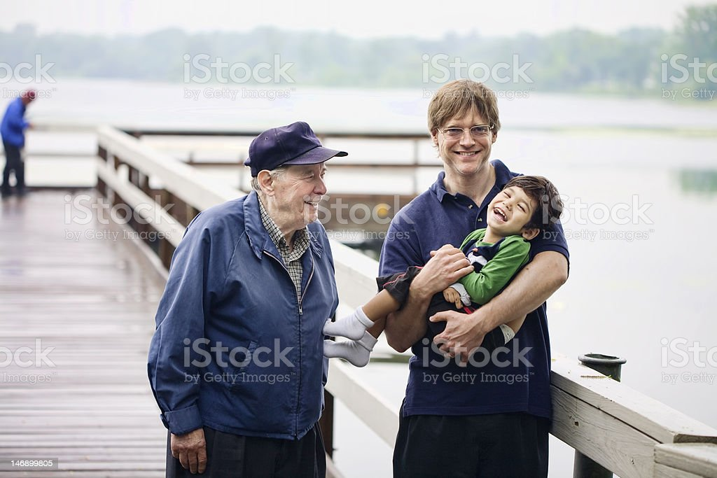 Three generations interacting together on the dock royalty-free stock photo