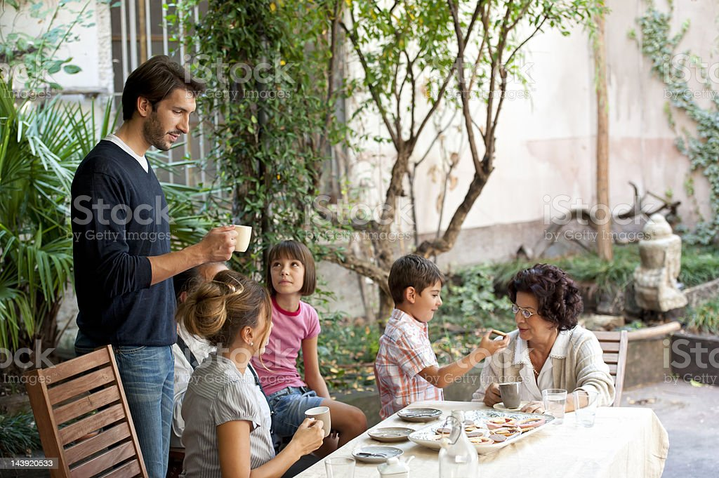 Three generations of a family at the sunday afternoon coffee royalty-free stock photo