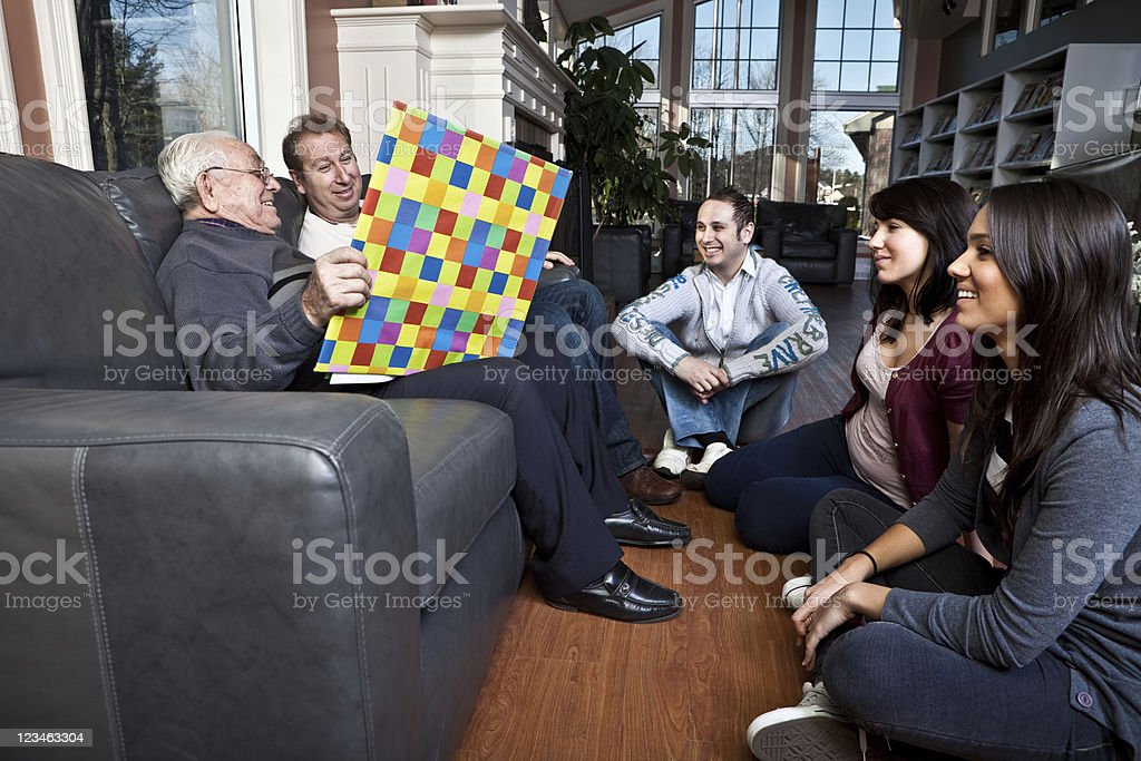 Three generations of a family sharing some quality time royalty-free stock photo