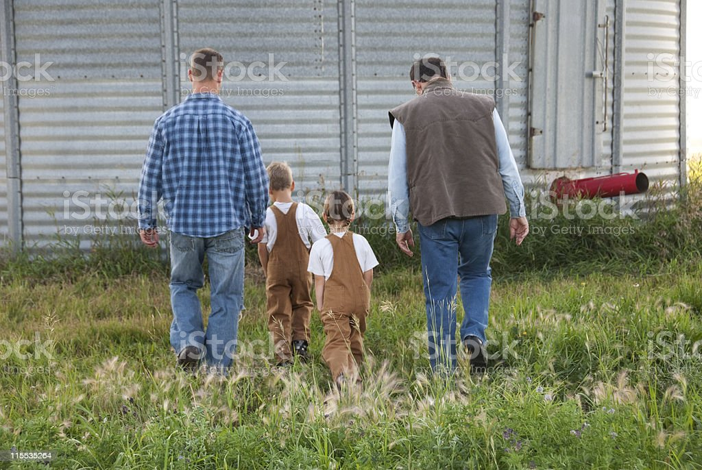 Three Generations of Farmers royalty-free stock photo