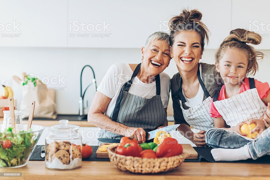 Three generations of femininity and happiness stock photo