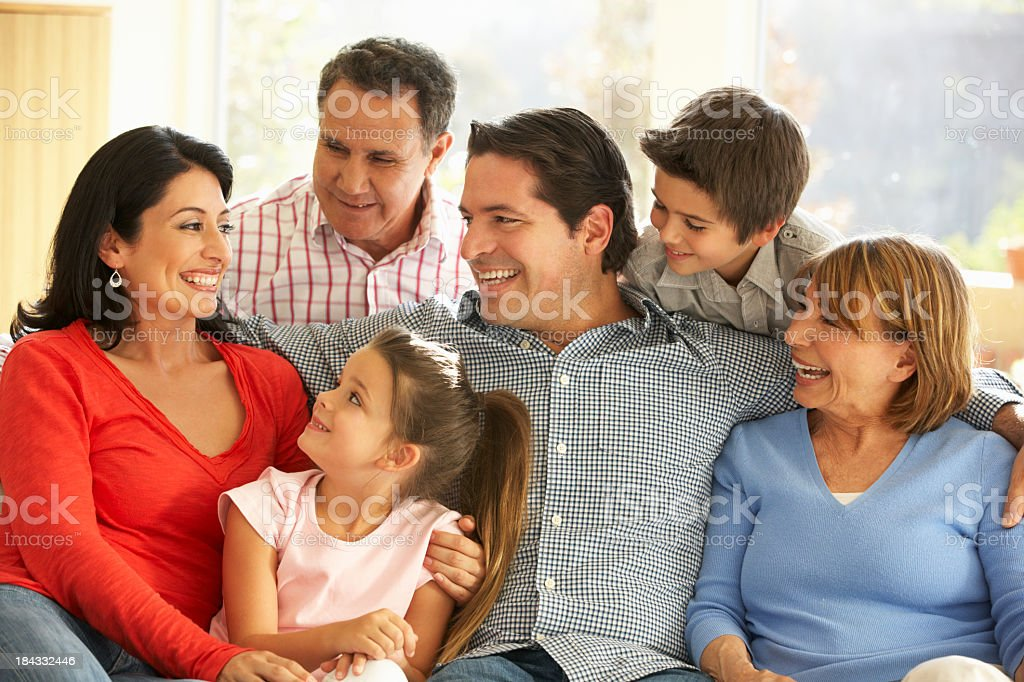 Three generations of Hispanic family laughing and smiling royalty-free stock photo