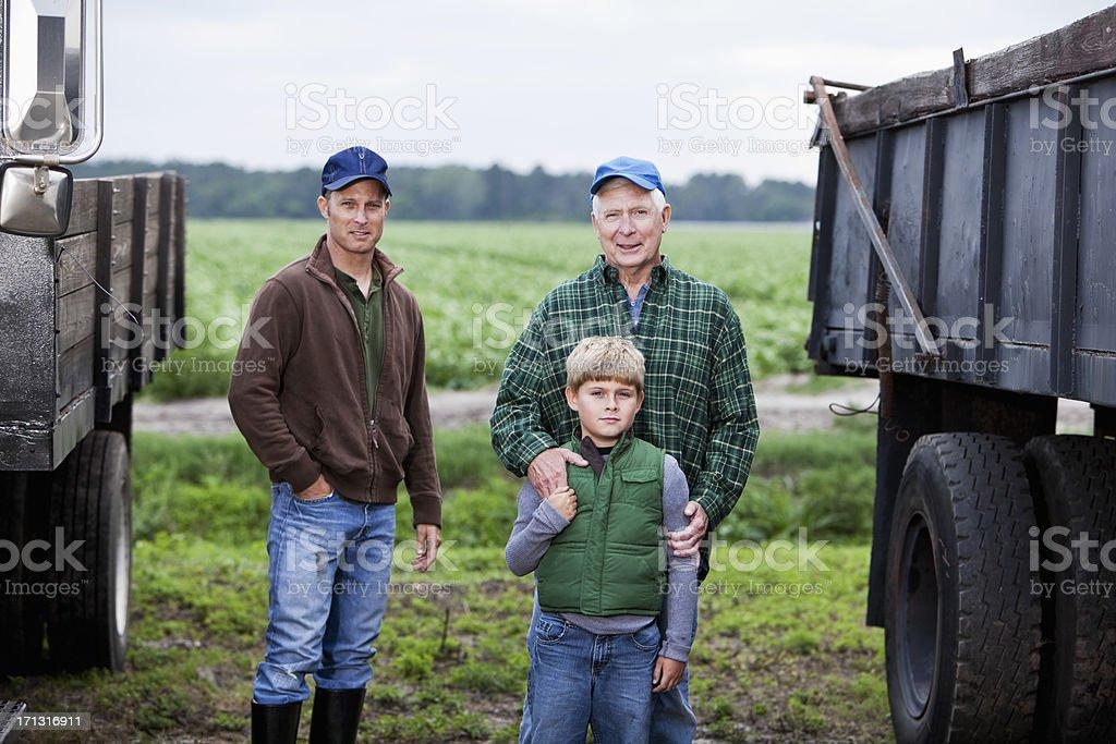 Three generations of men on family farm stock photo