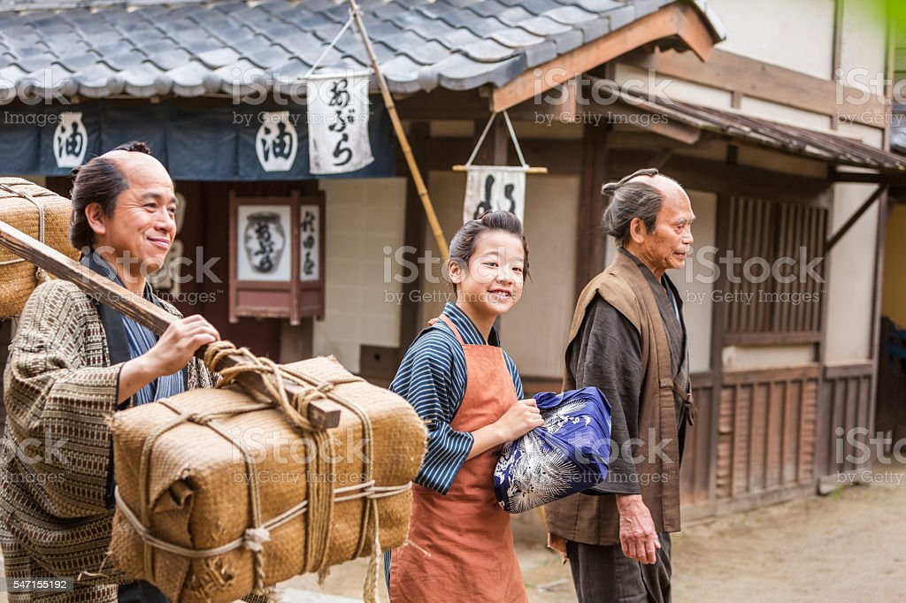 Three Generations of Tradional Japanese Farmers Taking Produce to Market stock photo