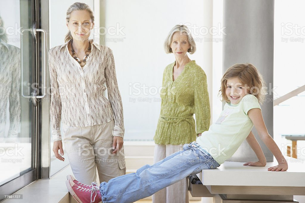 Three generations of women in living room of modern home royalty-free stock photo