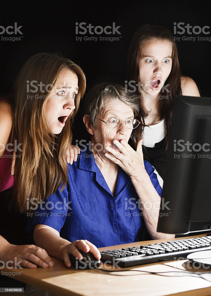 Three generations of women shocked by computer image royalty-free stock photo