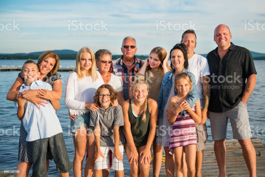 Three generations real family portrait outdoors in summer. stock photo