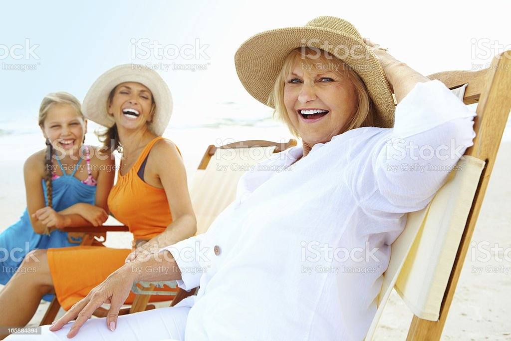 Three generations together enjoying at the beach royalty-free stock photo