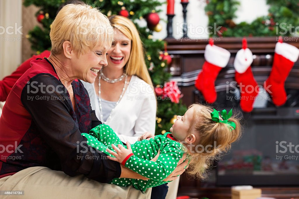 Three generations together on Christmas day stock photo