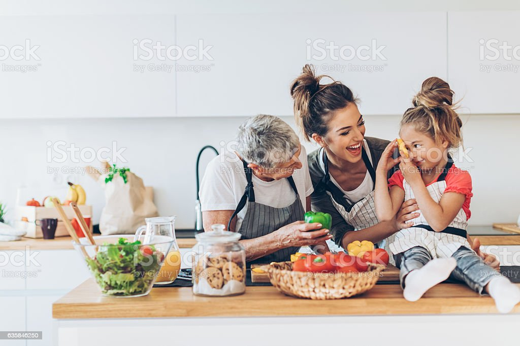Three generations women in the kitchen stock photo