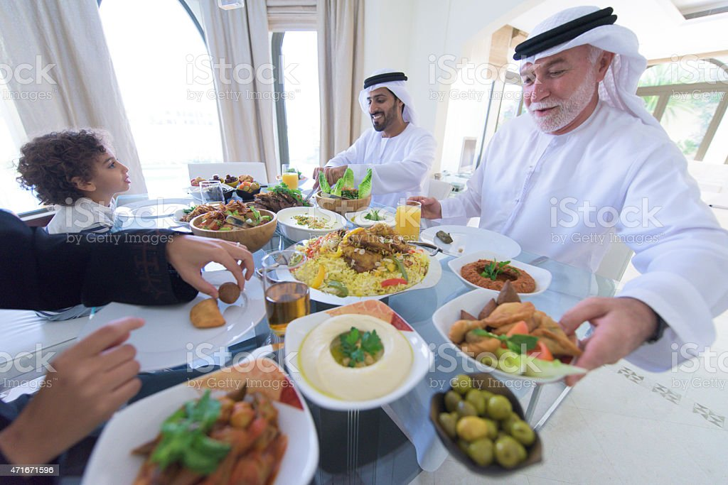 Three Genration Arabic family Enjoying lunch stock photo