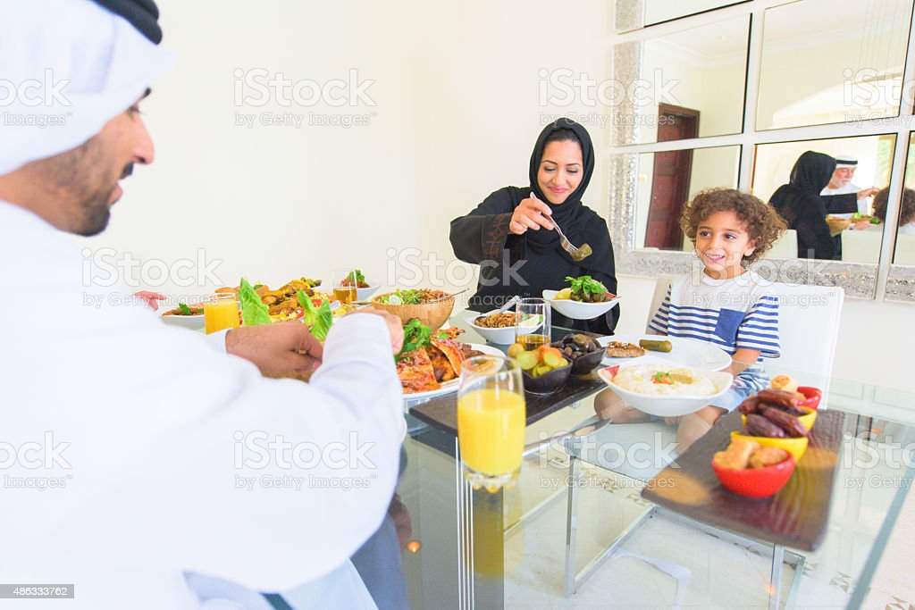 Three Genration Arabic family Enjoying lunch stock photo