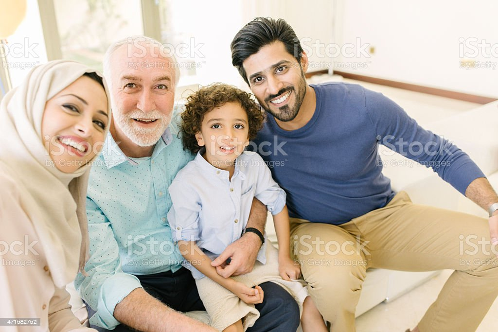 Three Genration Arabic family taking a selfie stock photo