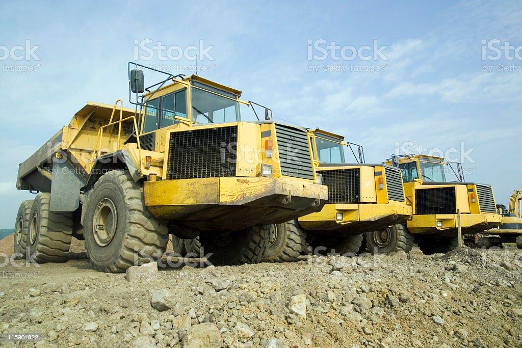 Three giant trucks stock photo