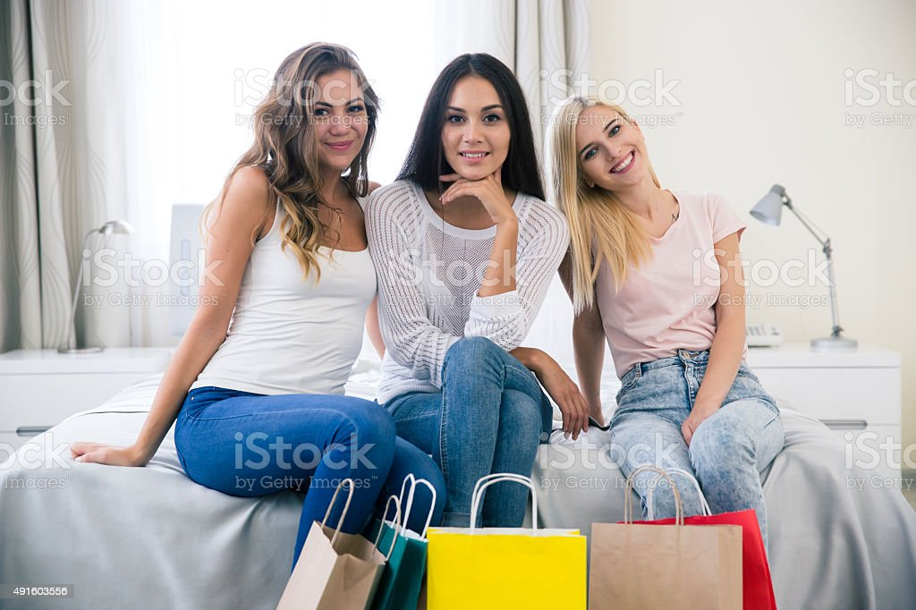 Three girlfriends with shopping bag stock photo