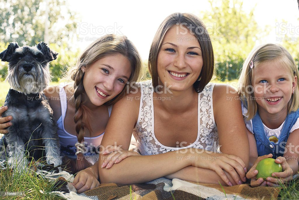 Three girls and a dog royalty-free stock photo