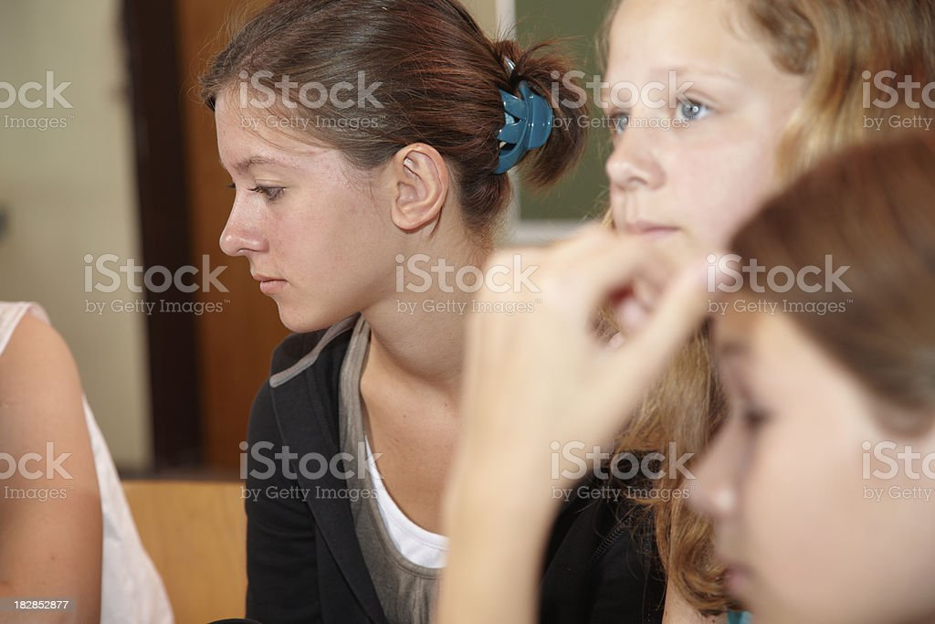 Three girls in a lesson stock photo