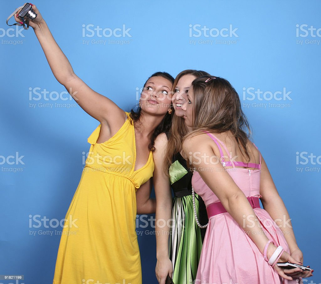 Three girls with camera royalty-free stock photo
