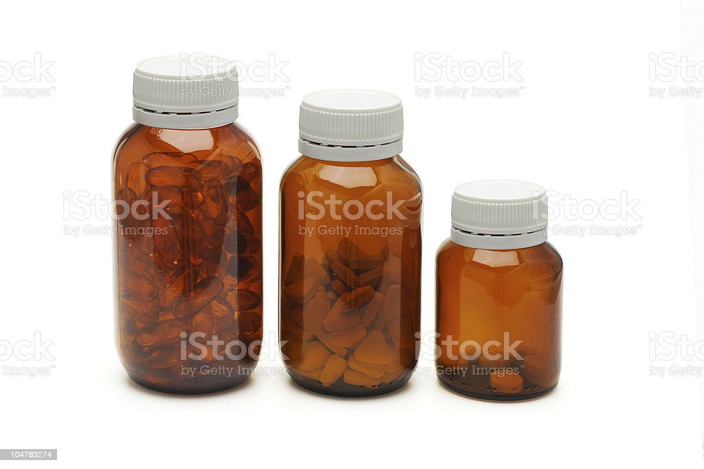 Three glass bottles of medicines royalty-free stock photo